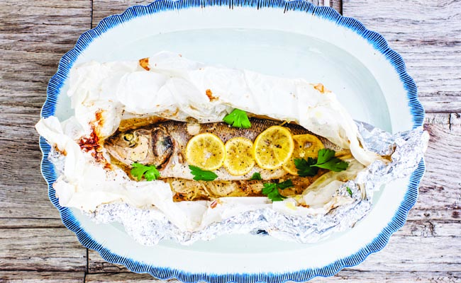 Barbecue on the beach sea bass parcels