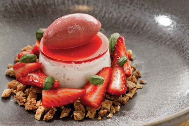 Strawberry pannacotta with yogurt, baked white chocolate and basil