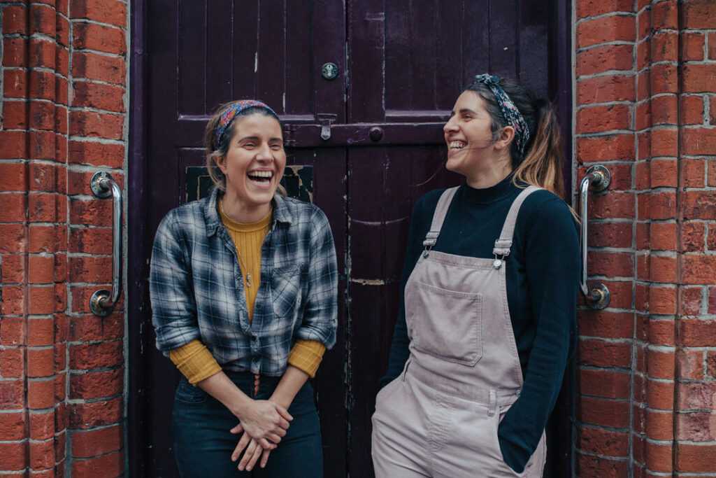 Twin sisters Gabriela and Lucia Evangelou standing outside Cosmic Kitchen in Plymouth